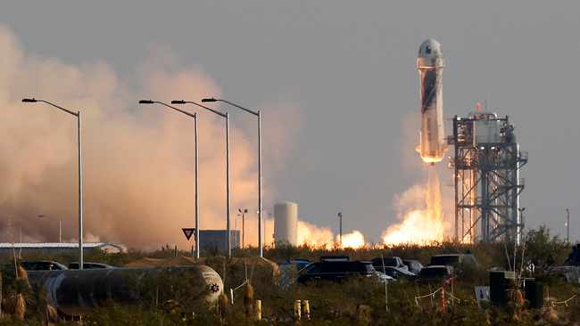 Bezos, Branson blasted for wasting their money on space travel