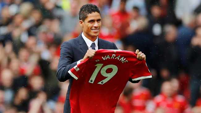 Raphael Varane signs four-year deal at Manchester United