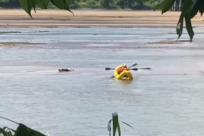 Watch: Firefighters discover 'body in the river' was a swimmer relaxing