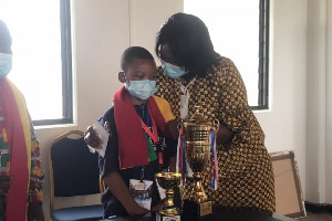 Central Regional Ministrer with Angel Arhin won a recent spelling contest in Dubai