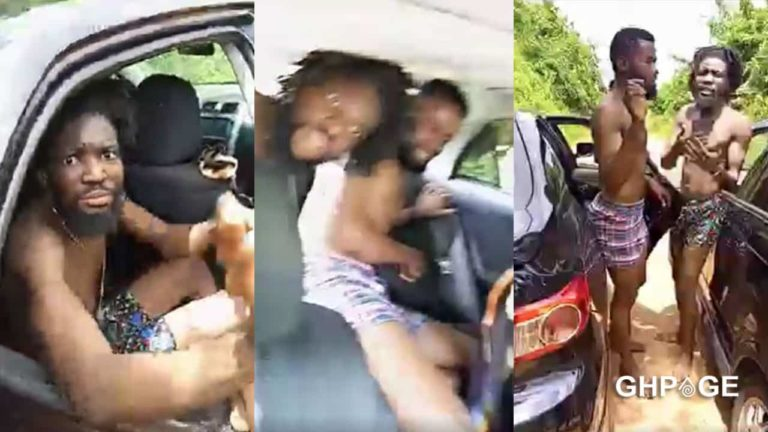 Two men caught bonking at the back of a car parked along a busy road (Video)